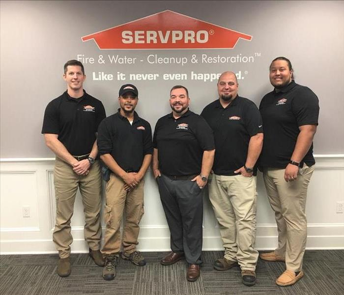 6 Men in Servpro shirts posing for a photo